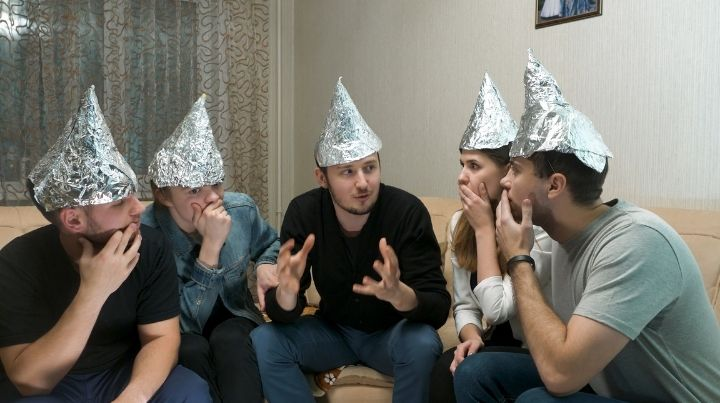 Group of people wearing tin foil hats
