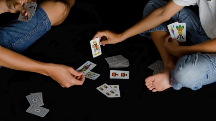 People playing cards during an emergency power outage
